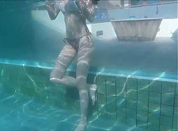 Sexy Asian Girl in Bikini Swimming in an Edgeless Pool