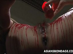 Pouring wax on her wet pussy and she loves the bdsm stuff